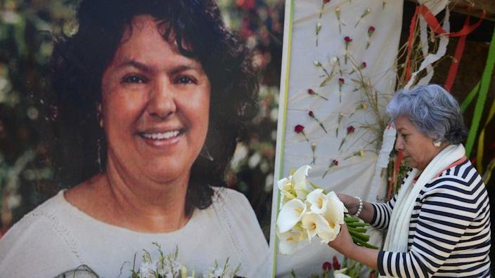 The president of the NGO Committee of Relatives of the Disappeared in Honduras, Bertha Oliva, lays a wreath on an alter in memory of murdered indigenous Honduran environmentalist Berta Caceres