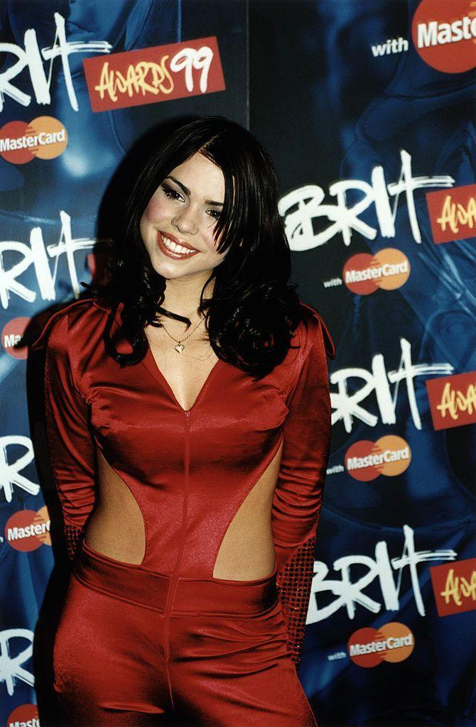 <p>The singer-turned-actor's 1999 look was nineties glam through and through, from the blush red cheeks to the dark red lipstick and cut-out satin jumpsuit.</p>