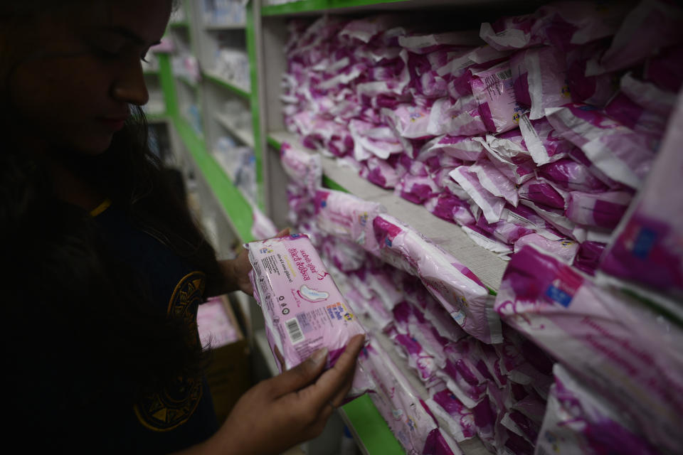 NEW DELHI, INDIA - AUGUST 27:  A woman looks at a Janaushadhi Suvidha sanitary napkin during the launch of Oxo-Biodegradable Suvidha Sanitary Napkins priced at Re 1  at Safdarjung Hospital on August 27, 2019 in New Delhi, India. The app was launched by Minister of State for Chemical and Fertilizers Mansukh Mandaviya and Minister of Chemicals and Fertilizers DV Sadananda Gowda. (Photo by Biplov Bhuyan/Hindustan Times via Getty Images)