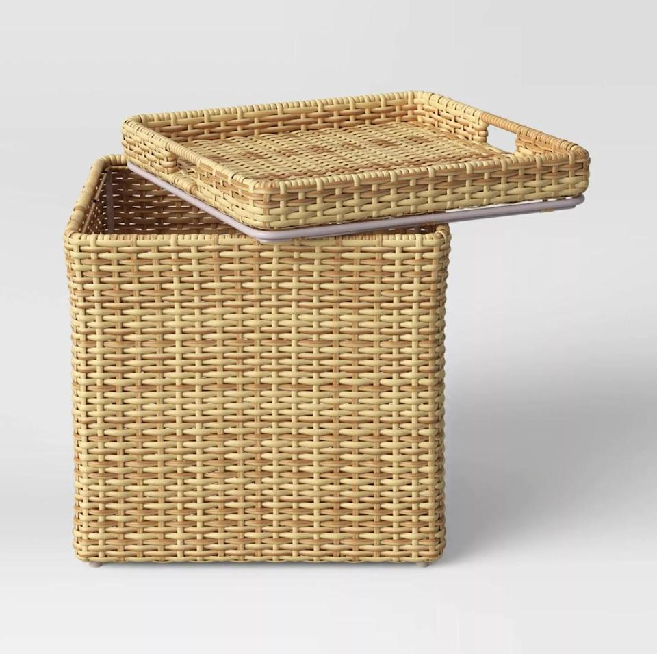<p>Give yourself some extra storage space and a table with this <span>Threshold Wicker Storage Patio Accent Table</span> ($59, originally $79).</p>
