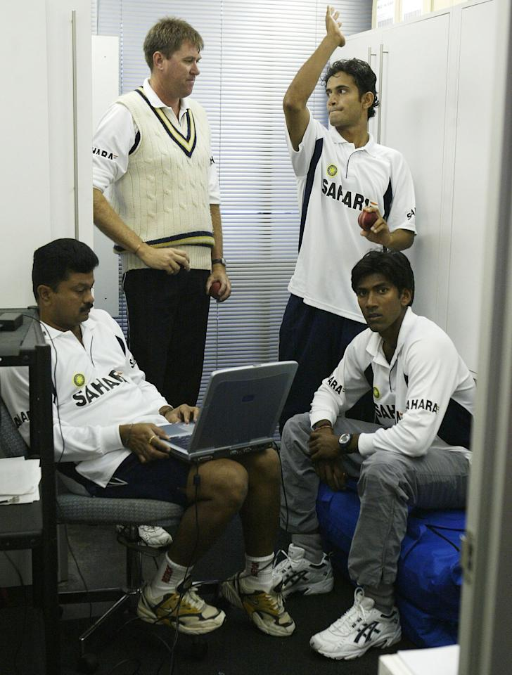 ADELAIDE, AUSTRALIA - DECEMBER 18:  Former Australian Fast Bowler and now Indian Bowling Coach Bruce Reid speaks with Irfan Pathan and Amit Bhandari of India during training in the indoors nets on December 18, 2003 at Bellerive Oval in Hobart, Australia.  (Photo by Hamish Blair/Getty Images)