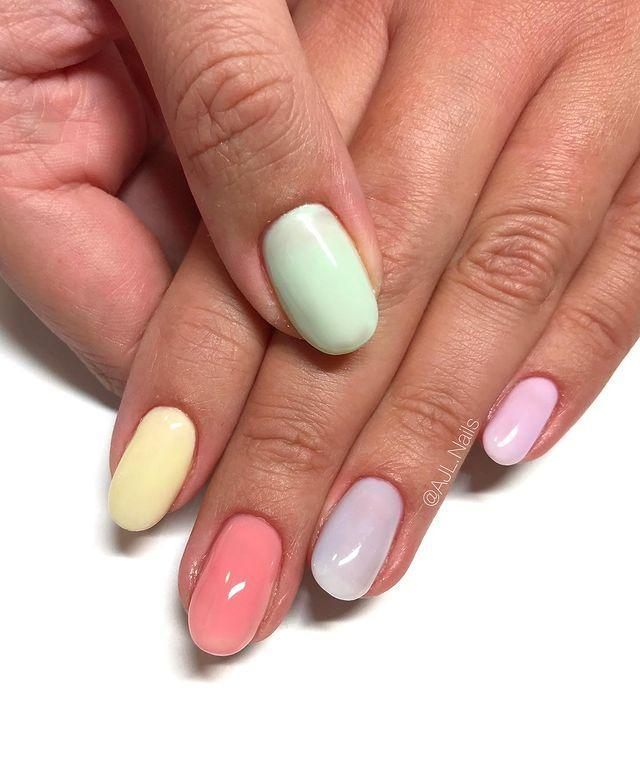 "<p>Manicurist Ashley Lane has an easy tip for these slightly sheer pastel-toned tips. Simply mix a little top coat into your favorite cream base for a more transparent, watery effect. </p><p><a href=""https://www.instagram.com/p/CNaGiaFso5L/"" rel=""nofollow noopener"" target=""_blank"" data-ylk=""slk:See the original post on Instagram"" class=""link rapid-noclick-resp"">See the original post on Instagram</a></p>"