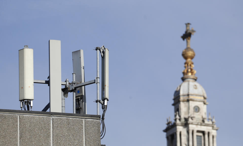 """Mobile network phone masts are visible in front of St Paul's Cathedral in the City of London, Tuesday, Jan. 28, 2020.The Chinese tech firm Huawei has been designated a """"high-risk vendor"""" but will be given the opportunity to build non-core elements of Britain's 5G network, the government has announced. The company will be banned from the """"core"""", of the 5G network, and from operating at sensitive sites such as nuclear and military facilities, and its share of the market will be capped at 35%. (AP Photo/Alastair Grant)"""