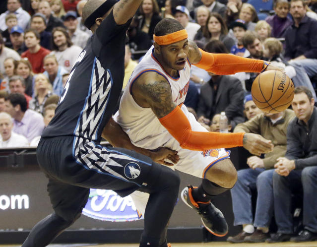 New York Knicks' Carmelo Anthony, right, leaves the floor as he drives around Minnesota Timberwolves' Dante Cunningham in the second half of an NBA basketball game, Wednesday, March 5, 2014, in Minneapolis. Anthony led the Knicks with 33 points in their 118-106 win. (AP Photo/Jim Mone)