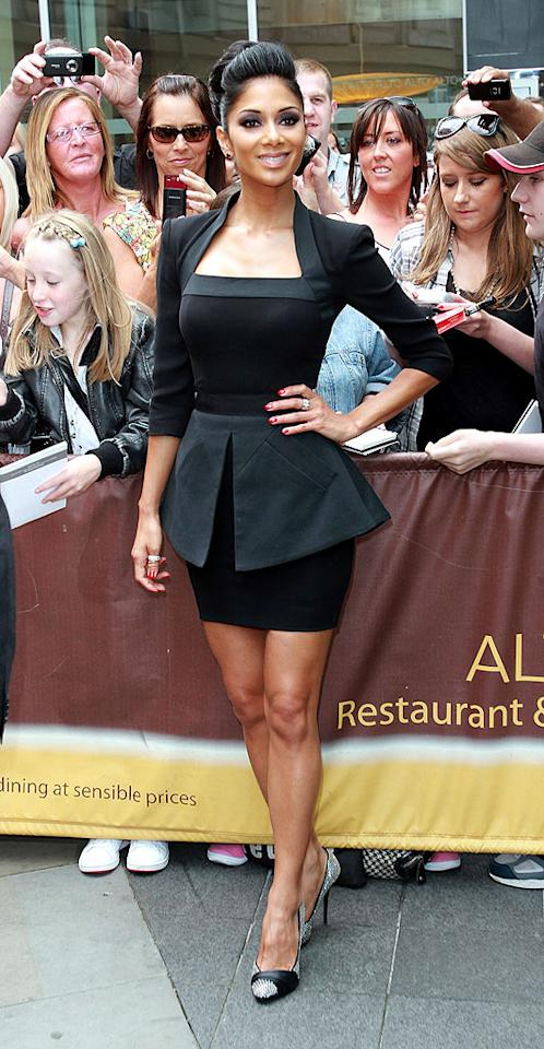 """But Victoria isn't the only fan of the posh line. Pussycat Doll Nicole Scherzinger strutted her stuff in a glamorous gray VB dress to the """"X Factor"""" auditions in Manchester. <a href=""""http://www.infdaily.com"""" target=""""new"""">INFDaily.com</a> - July 10, 2010"""
