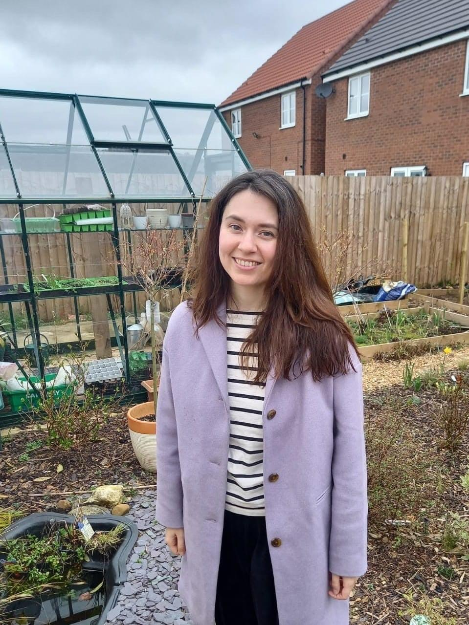 Hannah Copestake, 32, was forced to leave Australia, her home of three years, in July 2020 when the pandemic stopped some embassies from processing new visas. Pictured in her mother's garden in Yorkshire after returning to the UK in July 2020.Hannah Copestake