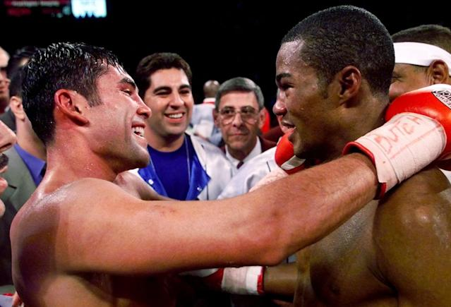 Oscar De La Hoya congratulates Felix Trinidad following their welterweight championship bout at the Mandalay Bay Events Center on Sept. 18, 1999 in Las Vegas. Trinidad won the bout by way of decision after 12 rounds. (AP Photo/Eric Draper)