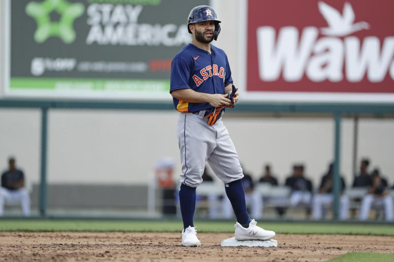 Houston Astros' Jose Altuve reacts after hitting an RBI double during the third inning of a spring training baseball game Detroit Tigers Monday, Feb. 24, 2020, in Lakeland, Fla. (AP Photo/Frank Franklin II)