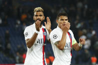 PSG's Thiago Silva, right, and PSG's Eric Maxim Choupo-Moting applaud fans at the end of the Champions League group A soccer match between PSG and Real Madrid at the Parc des Princes stadium in Paris, Wednesday, Sept. 18, 2019. (AP Photo/Francois Mori)