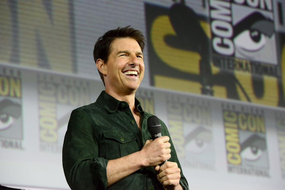 "SAN DIEGO, CALIFORNIA - JULY 18: Tom Cruise makes a surprise appearance to discuss ""Top Gun: Maverick"" during 2019 Comic-Con International at San Diego Convention Center on July 18, 2019 in San Diego, California. (Photo by Albert L. Ortega/Getty Images)"