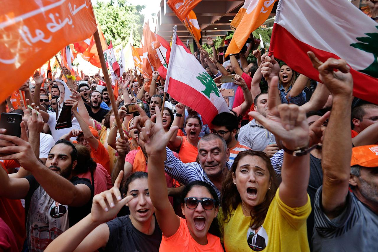 <p>Supporters in Beirut of Christian leader Michel Aoun, holding Free Patriotic Movement and Lebanese flags, celebrate the election of Aoun as the new president of Lebanon, Monday, Oct. 31, 2016. Lebanon's parliament elected Aoun, an 81-year-old former army commander and ally of Hezbollah, as president, ending a two-year political vacuum. (Hassan Ammar/AP) </p>
