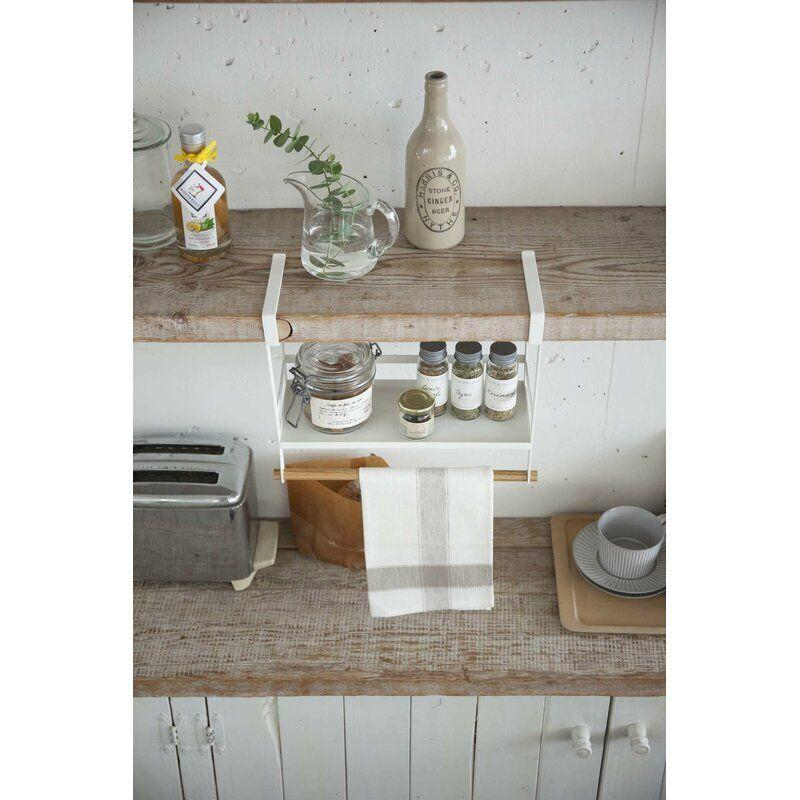 """Use t<a href=""""https://fave.co/3owU2Hr"""" target=""""_blank"""" rel=""""noopener noreferrer"""">his undershelf basket</a> to store everyday spices, coffee and tea or anything else you need handy at a moment's notice. It also includes a practical towel rack. Measure to be sure it'll fit your cabinets.<a href=""""https://fave.co/3owU2Hr"""" target=""""_blank"""" rel=""""noopener noreferrer"""">Get it for $25 at Wayfair</a>."""