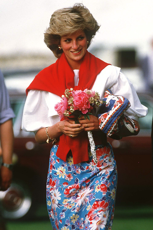 <p>This ensemble is so excellently put together it made us bow down in fashion respect. Note how it all matches, the flashes of red in the skirt and on the bag, to match the sweater so expertly. And then the clashing pink home made bouquet. We. Can't. Even. Deal.</p>