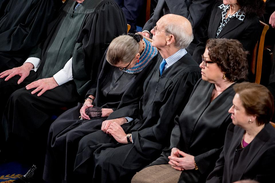 Justice Stephen Breyer discreetly nudges Justice Ruth Bader Ginsburg to keep her awake as President Barack Obama delivers the State of the Union Address. (Photo: Andrew Harnik for the Washington Post via Getty)