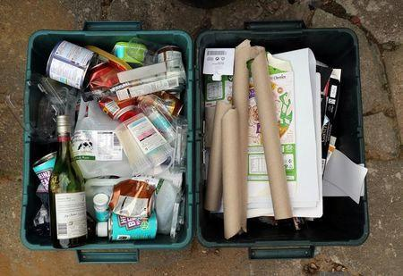 Domestic waste that has been sorted into plastics, glass, metals and card is left outside to be recycled in London, Britain August 14, 2017. REUTERS/Russell Boyce