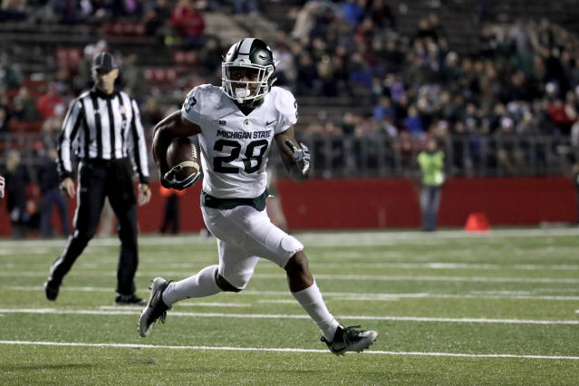 Michigan State running back Madre London runs with the ball against Rutgers during the second half of an NCAA college football game, Saturday, Nov. 25, 2017, in Piscataway, N.J. (AP Photo/Julio Cortez)
