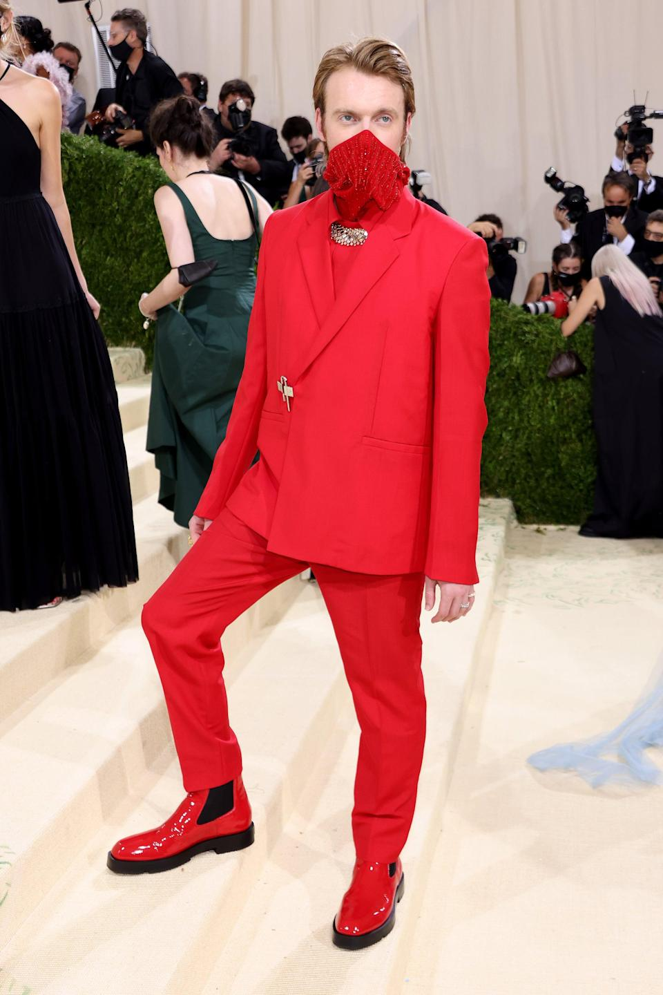 <p>Wearing a Givenchy suit and Cartier jewels. </p>