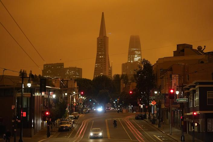 "The Transamerica Pyramid and Salesforce Tower are partially obscured by an orange smoky haze late Wednesday in San Francisco. <span class=""copyright"">(Eric Risberg / Associated Press )</span>"