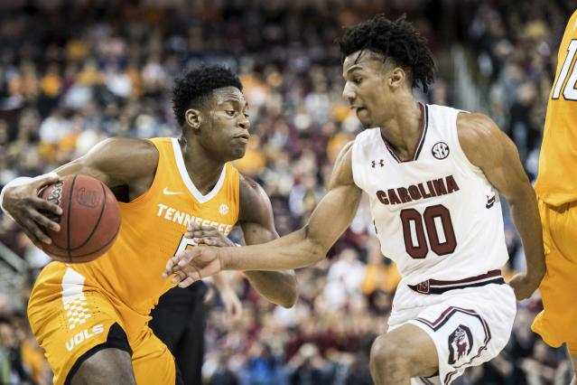 Tennessee guard Admiral Schofield, left, drives to the hoop against South Carolina guard A.J. Lawson (00) during the first half of an NCAA college basketball game Tuesday, Jan. 29, 2019, in Columbia, S.C. (AP Photo/Sean Rayford)