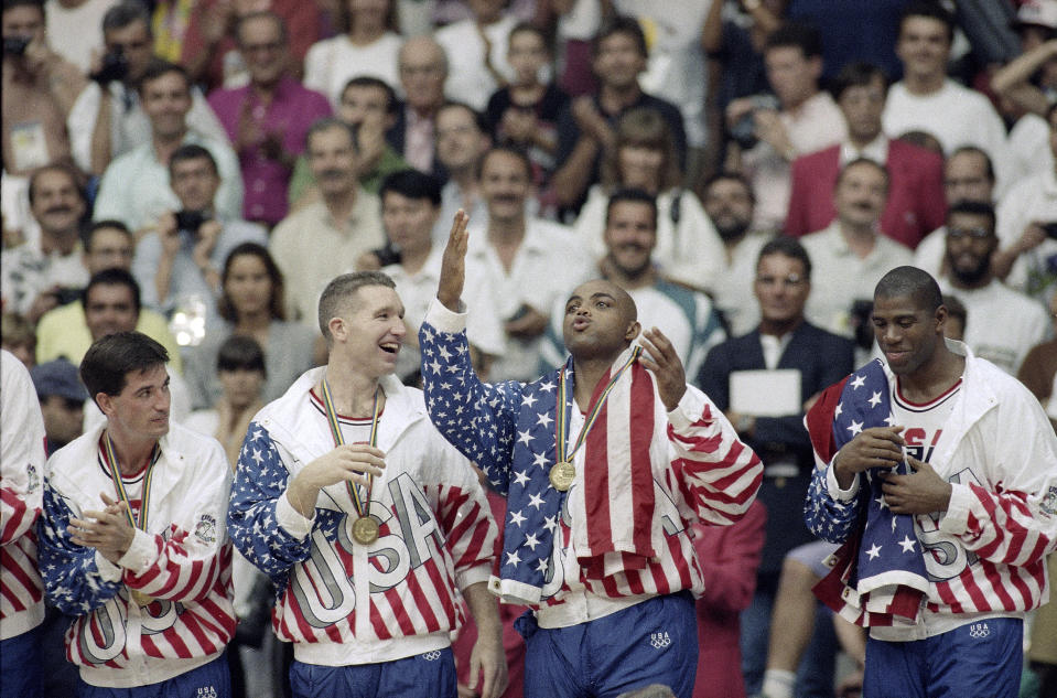 Charles Barkley and Magic Johnson also draped American flags over their shoulders. (AP Photo/John Gaps III, File)