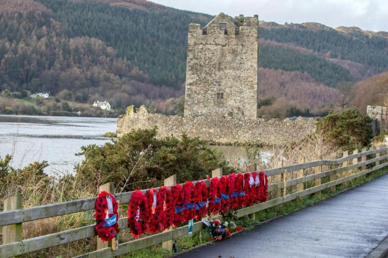 Outside the town, the spot of a 1979 attack on British troops remains marked by a rank of poppy wreaths