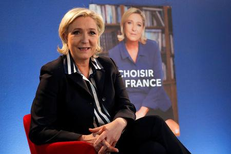 Marine Le Pen, French National Front (FN) candidate for 2017 presidential election, poses before an interview with Reuters in Paris, France