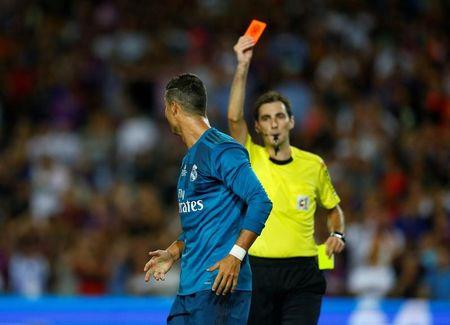 FILE PHOTO: Soccer Football - Barcelona v Real Madrid Spanish Super Cup First Leg - Barcelona, Spain - August 13, 2017   Real Madrid's Cristiano Ronaldo is shown a red card by referee Ricardo de Burgos Bengoetxea after receiving a second yellow card for simulation   REUTERS/Juan Medina