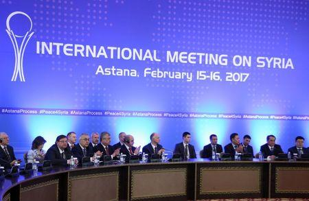 Participants of Syria peace talks attend a meeting in Astana