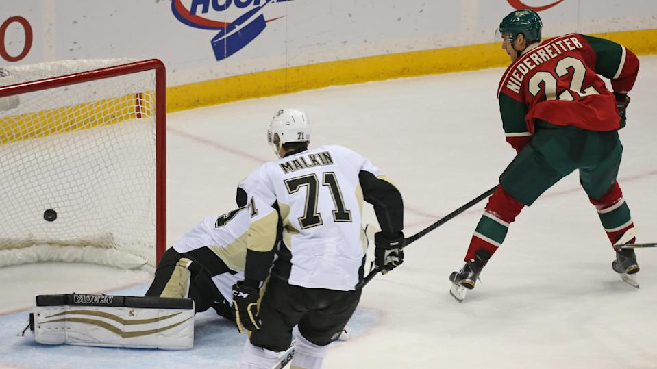 Minnesota Wild's Nino Niederreiter, right, of Switzerland, shoots the puck past Pittsburgh Penguins goalie Thomas Greiss for a short-handed goal in the third period of an NHL hockey game, Tuesday, Nov. 4, 2014, in St. Paul, Minn. Pittsburgh won 4-1. (AP Photo/Bruce Bisping)