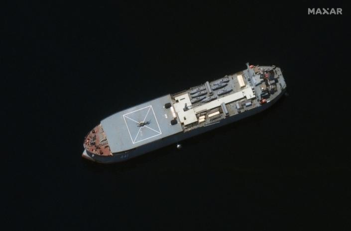In this satellite photo provided by Maxar Technologies, the Iranian navy vessel Makran is seen off Lark Island, Iran, May 10, 2021. An Iranian destroyer and support vessel are now sailing in the Atlantic Ocean in a rare mission far from the Islamic Republic, Iran's state TV reported on Thursday, June 10, 2021, without offering the vessels' final destination. (©2021 Maxar Technologies via AP)