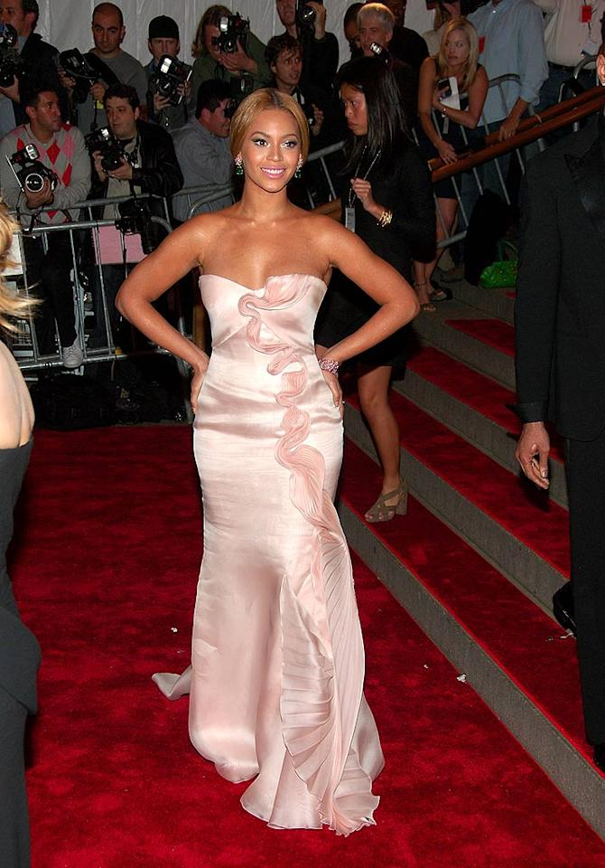 "Beyonce showed off her trademark curves in a strapless hip-hugging pale pink dress. Michael Loccisano/<a href=""http://www.filmmagic.com/"" target=""new"">FilmMagic.com</a> - May 5, 2008"