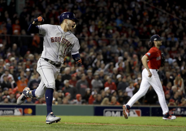 Houston Astros' Carlos Correa celebrates after his RBI-single against the Boston Red Sox during the sixth inning in Game 1 of a baseball American League Championship Series on Saturday, Oct. 13, 2018, in Boston. (AP Photo/David J. Phillip)