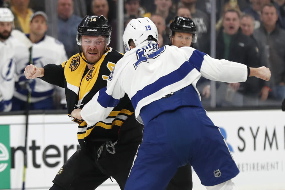 Boston Bruins' Chris Wagner (14) fights with Tampa Bay Lightning's Barclay Goodrow during the first period of an NHL hockey game Saturday, March 7, 2020, in Boston. (AP Photo/Winslow Townson)