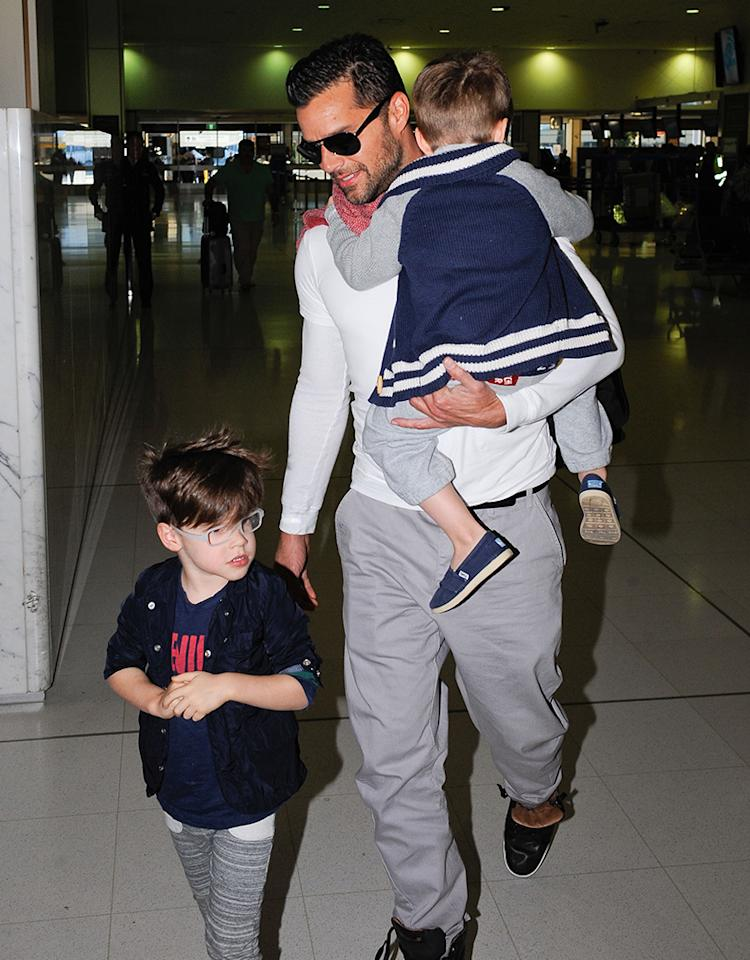 June 18, 2013: Ricky Martin and his sons Matteo (glasses) and Valentino depart Sydney airport in Sydney, Australia. 