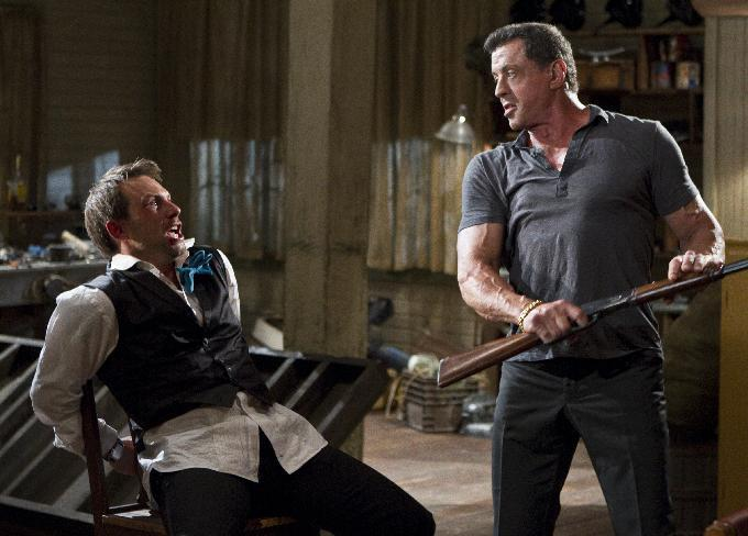 "This film image released by Warner Bros. Pictures shows Christian Slater, left, and Sylvester Stallone in a scene from ""Bullet to the Head."" (AP Photo/Warner Bros. Pictures, Frank Masi)"