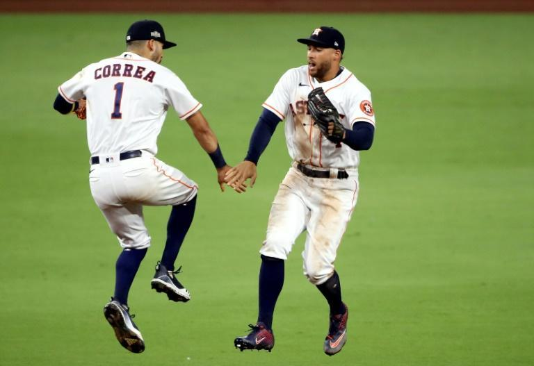 Houston's Carlos Correa and George Springer celebrate the Astros' 4-3 win over the Tampa Bay Rays in game four of baseball's American League Championship Series
