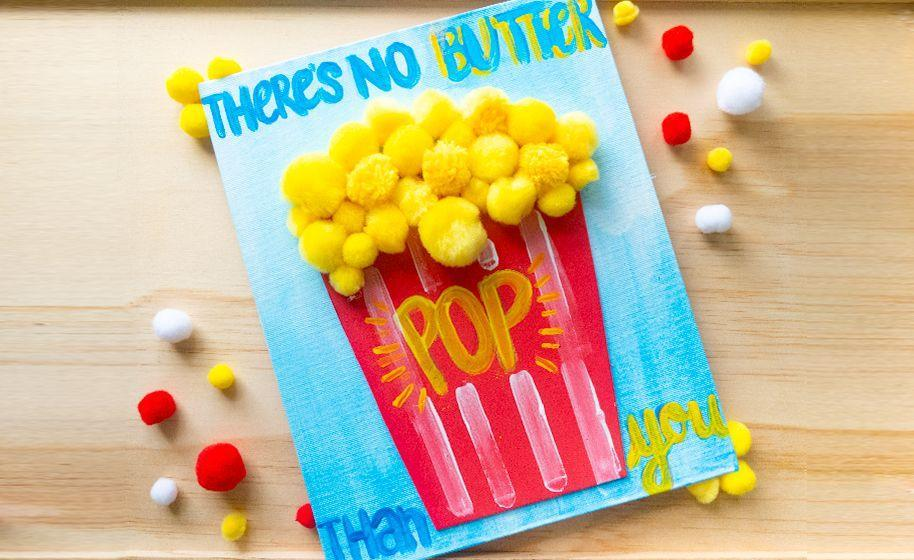 """<p>If Dad is a movie buff, this card will bring him good cinema memories without all the sticky butter. Pom-poms transform into popcorn kernels with just a little creativity.</p><p><a href=""""https://www.craftprojectideas.com/fathers-day-popcorn-pom-craft/"""" rel=""""nofollow noopener"""" target=""""_blank"""" data-ylk=""""slk:Get the tutorial at Craft Project Ideas »"""" class=""""link rapid-noclick-resp""""><em>Get the tutorial at Craft Project Ideas »</em></a></p>"""