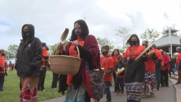 Vigil-keepers were asked to wear orange to commemorate the 215 children whose remains have been discovered at a former residential school in Kamloops, B.C. (Brian Higgins/CBC - image credit)