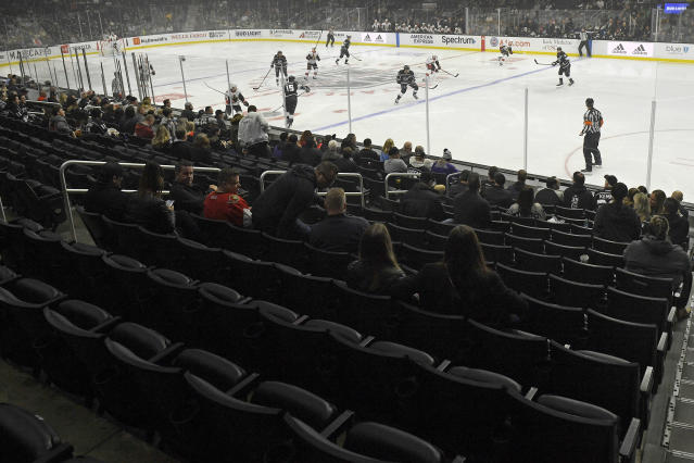 Empty seats are seen at the start of an NHL hockey game between the Los Angeles Kings and the Ottawa Senators Wednesday, March 11, 2020, in Los Angeles. (AP Photo/Mark J. Terrill)