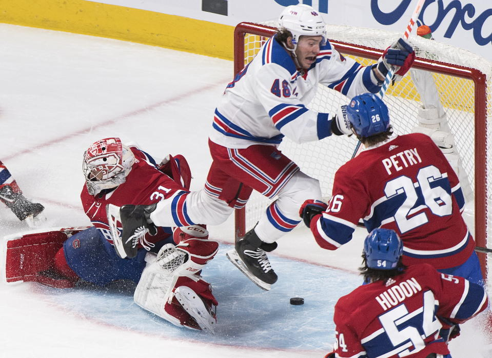 New York Rangers' Brendan Lemieux (48) scores against Montreal Canadiens goaltender Carey Price as Canadiens' Charles Hudon (54) and Jeff Petry (26) defend during the third period of an NHL hockey game Saturday, Nov. 23, 2019, in Montreal. (Graham Hughes/The Canadian Press via AP)