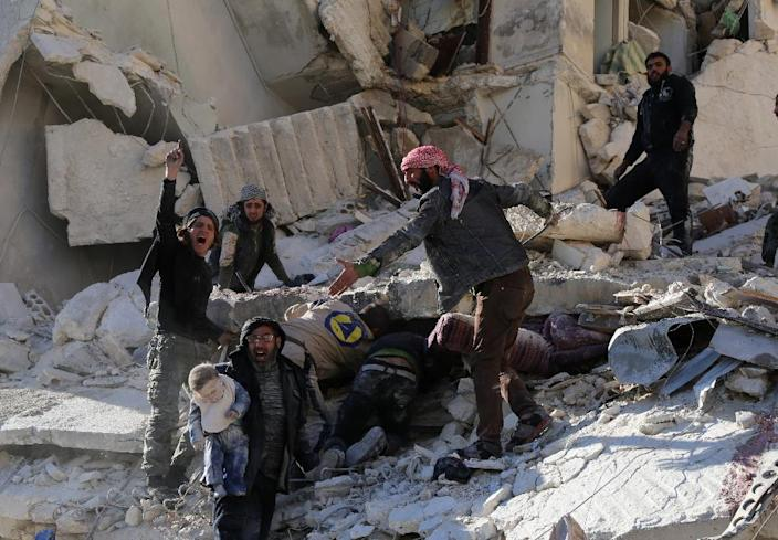 Rescue workers search for victims amid the rubble of a building following a reported air strike by Syrian government forces on Aleppo's Sukkari neighbourhood (AFP Photo/Baraa al-Halabi)