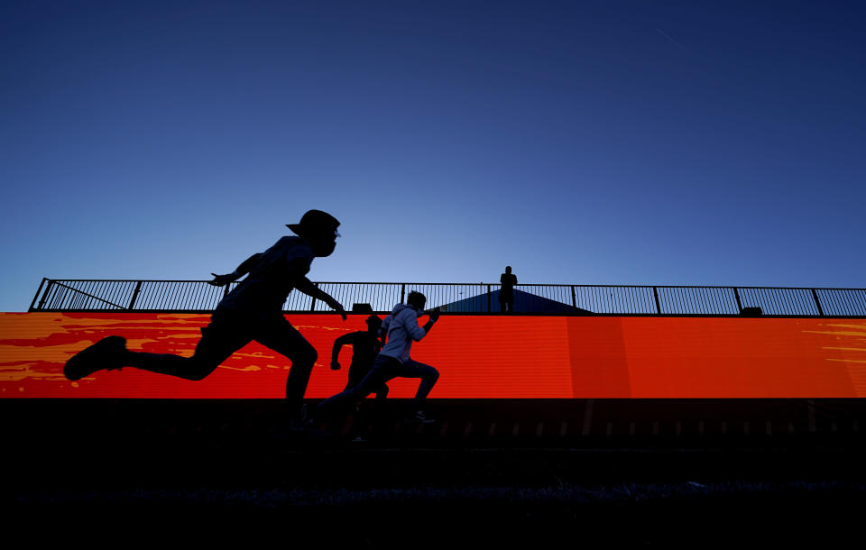 Football fans run the 40-yard dash at the NFL Experience for Super Bowl LV Friday, Jan. 29, 2021, in Tampa, Fla. (AP Photo/David J. Phillip)