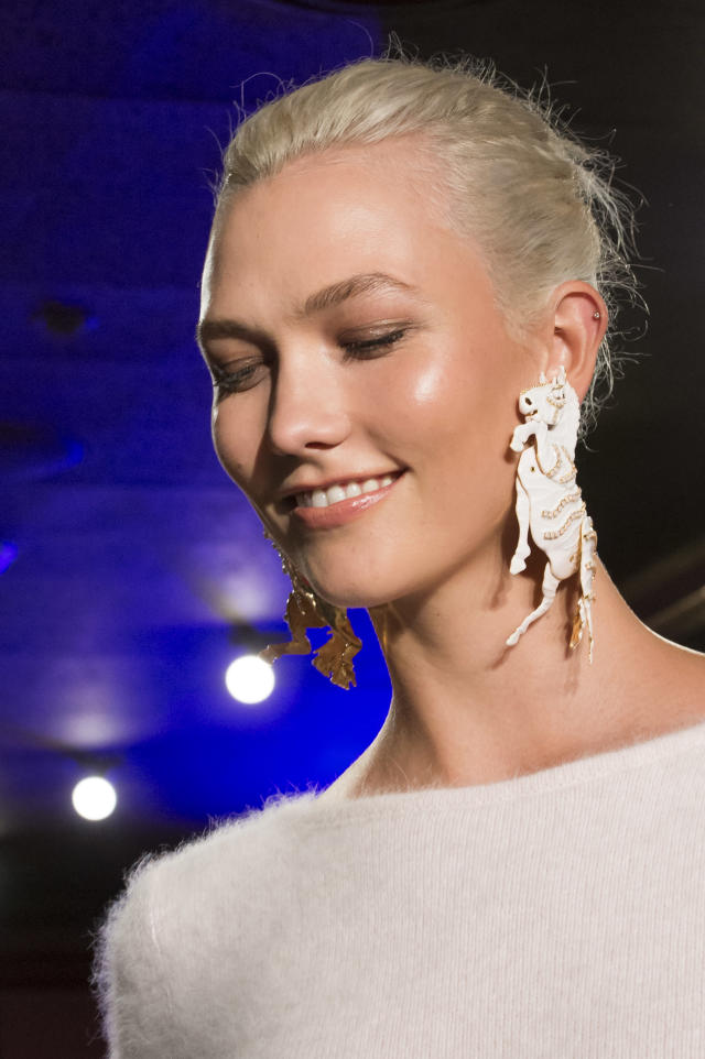 <p><i>Karlie Kloss wears ivory-colored horse-shaped earrings from the SS18 Brandon Maxwell collection. (Photo: ImaxTree) </i></p>