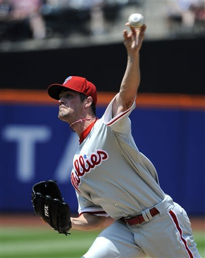 Philadelphia Phillies starting pitcher Cole Hamels throws against the New York Mets in the second inning of a baseball game on Monday, May 28, 2012, at Citi Field in New York. (AP Photo/Kathy Kmonicek)