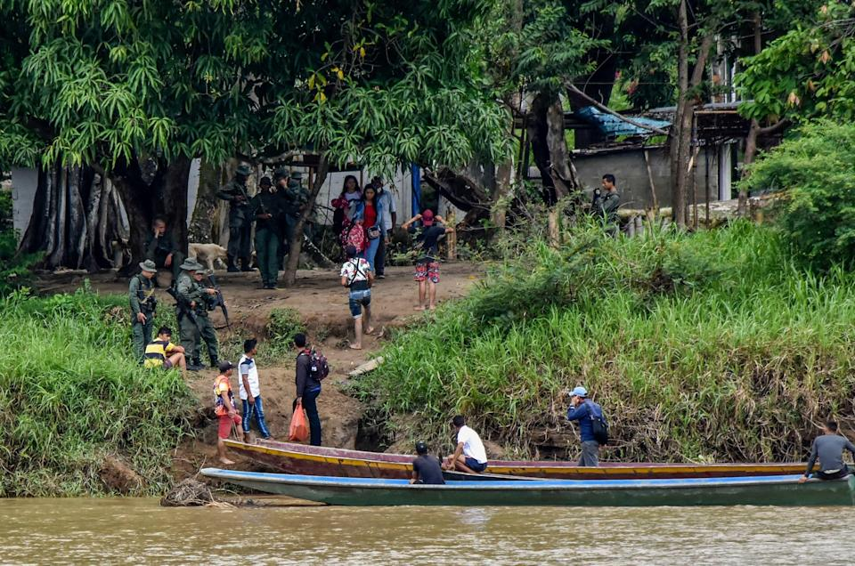 Venezuelans cross the Arauca river from La Victoria, Apure state, Venezuela to Arauquita municipality, Arauca department, Colombia, on March 26, 2021.