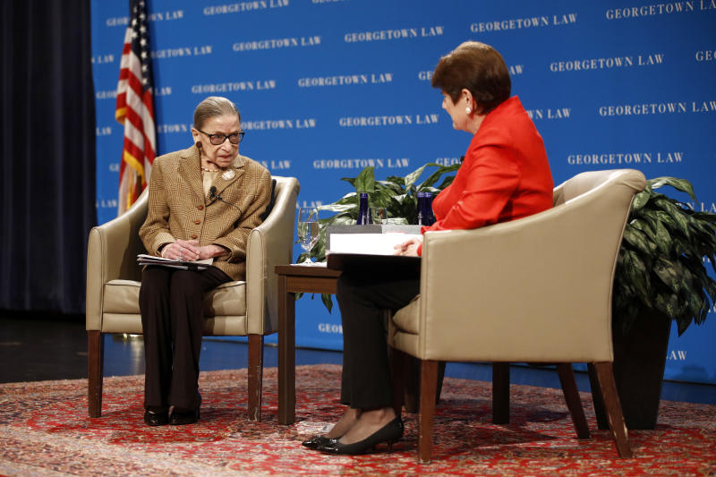 U.S. Supreme Court Associate Justice Ruth Bader Ginsburg speaks with Circuit Judge M. Margaret McKeown of the U.S. Court of Appeals for the Ninth Circuit during a discussion on the 100th anniversary of the ratification of the 19th Amendment at Georgetown University Law Center in Washington, Monday, Feb. 10, 2020. (AP Photo/Patrick Semansky)