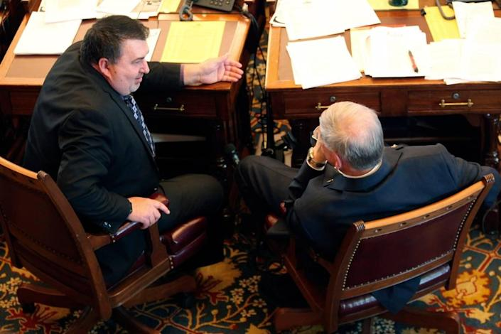 Kansas Senator Rob Olson, R-Oreisa, left speaks with Senator Ron Ryckman Sr., R-Mead, during a debate at Topeka's State Capitol last month. Olson has played an important role in drafting the final version of the bill, which aims to modernize the state's unemployment system and have legislators monitor technology upgrades for the Kansas Department of Labor.