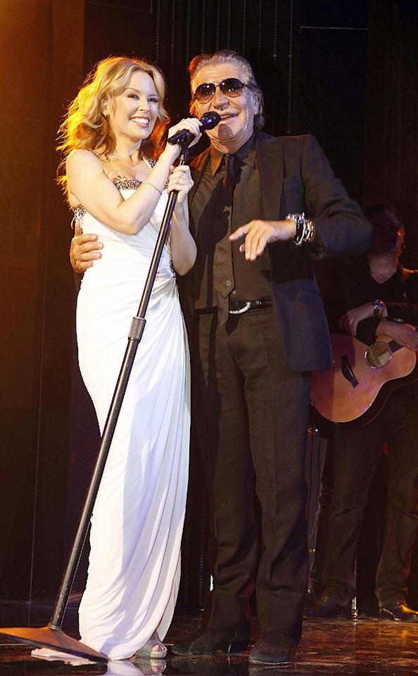 "Pop star Kylie Minogue handed the mic to the designer at one point, but mostly she kept it for crooning her hits like ""Can't Get You Out of My Head"" for the crowd of about 1,200. The price tag for the party was reportedly a cool $2 million. Eric Ryan/<a href=""http://www.gettyimages.com/"" target=""new"">GettyImages.com</a> - September 29, 2010"