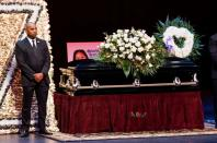 A man stands guard next to the casket for late rapper Marcel Theo Hall, known by his stage name Biz Markie, during the funeral service in Patchogue, New York