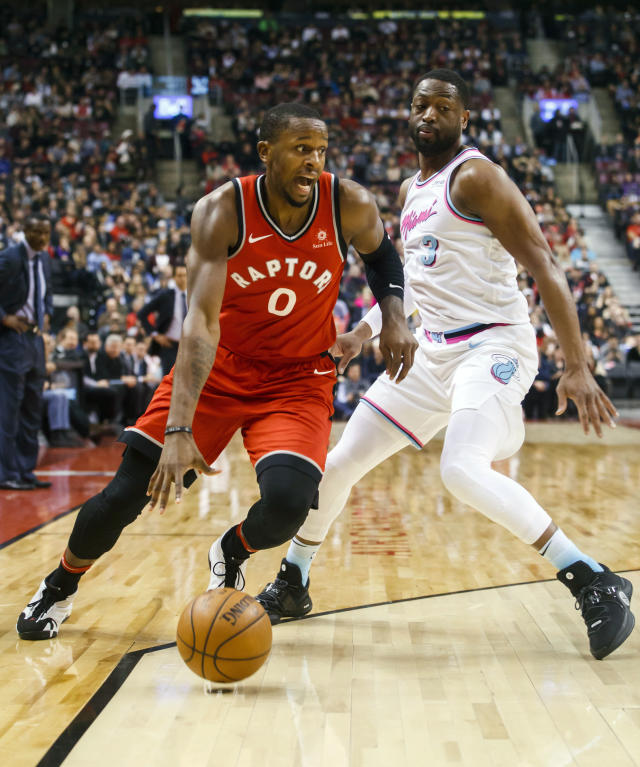 Toronto Raptors' CJ Miles goes to the basket against Miami Heat guard Dwyane Wade during the first half of an NBA basketball game, Tuesday, Feb. 13, 2018, in Toronto. (Mark Blinch/The Canadian Press via AP)